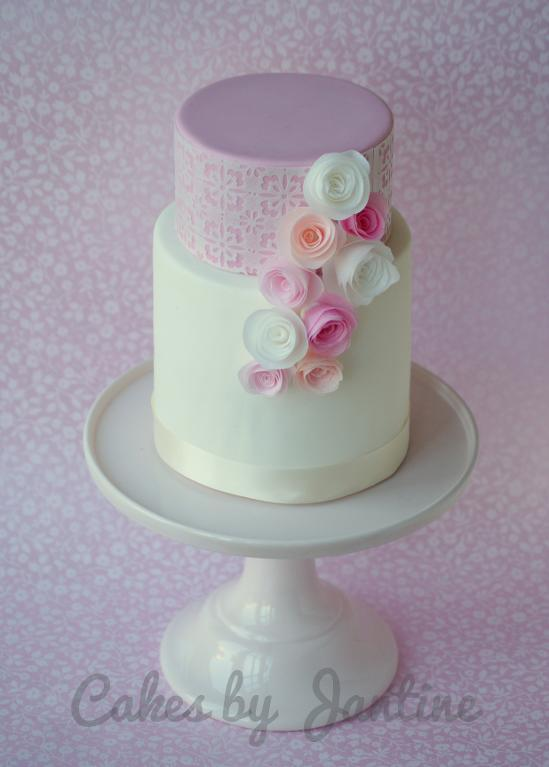 Rolled Wafer Paper Roses on a Two-Tier Cake