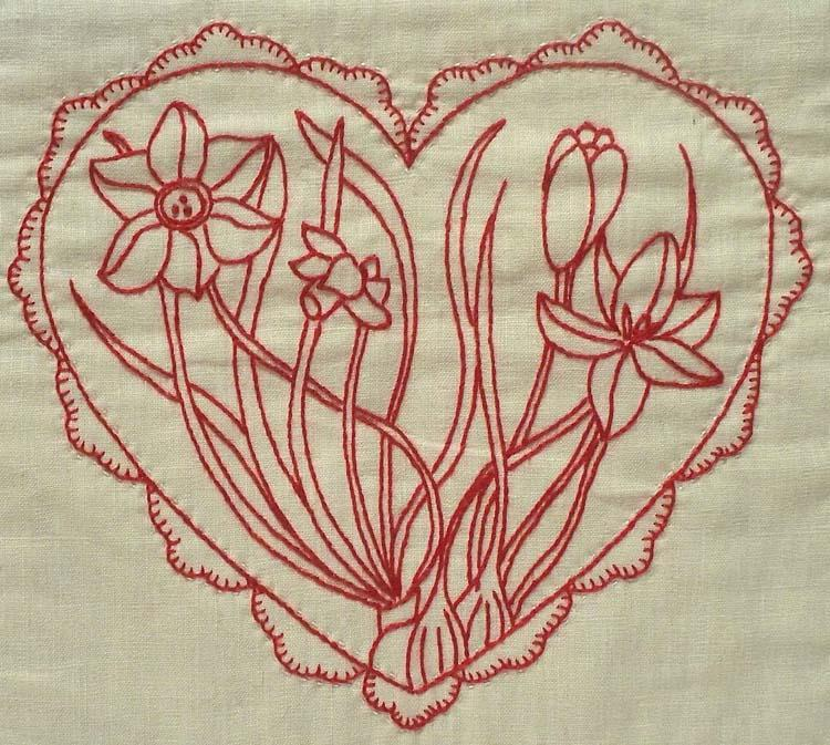 Redwork embroidery of flowers inside a heart