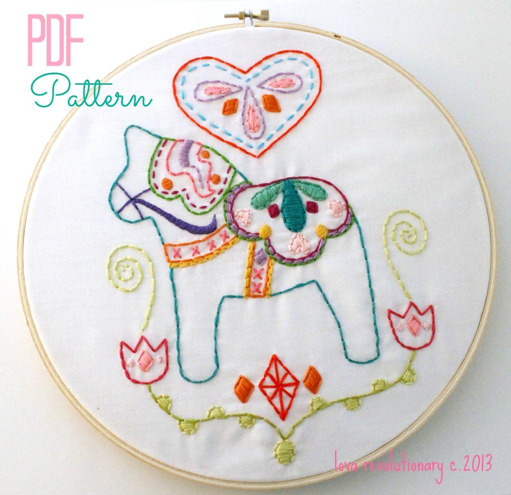 hand embroidered dala horse surrounded by a heart and flowers