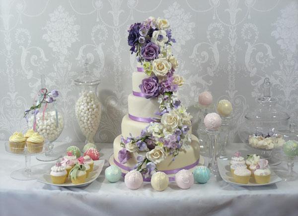 Purple rose wedding cake by Juniper Cakery