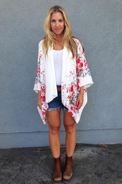 Woman Wearing a Kimono Cardigan and Jean Shorts