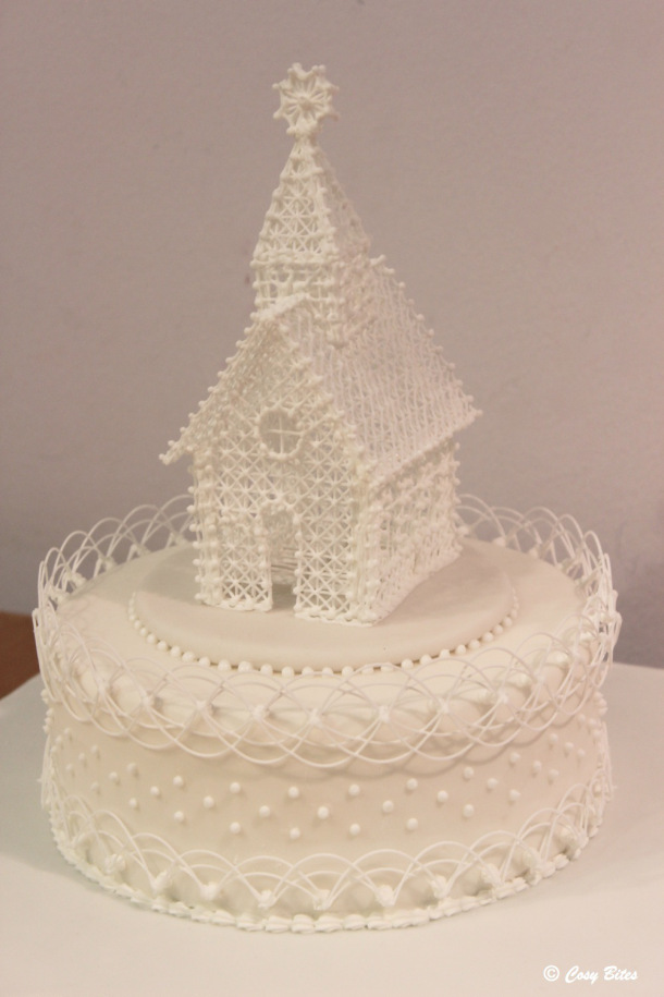 A Cake With Royal Icing Church and Stringwork