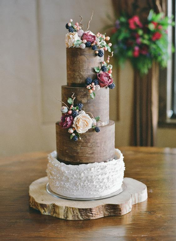 Rustic Wedding Cake Decorated with Sugar Berries, Leaves and Flowers