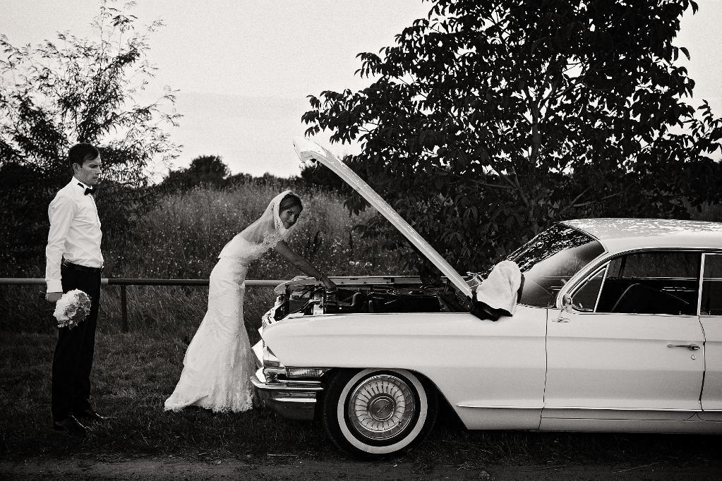 Wedding Couple Working on Car