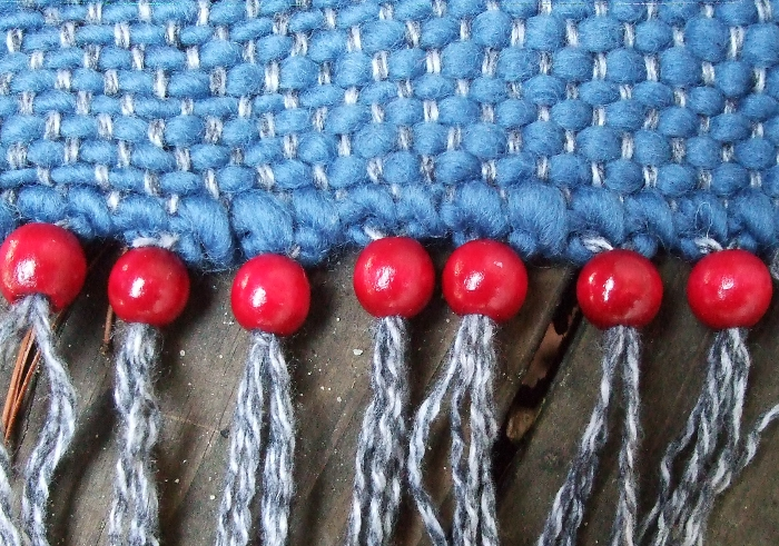 weaving with red beaded fringe
