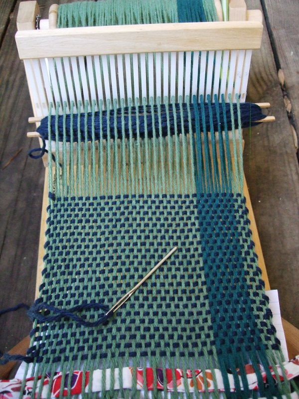 Blue weaving with needle for hem stitch