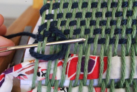 hem stitch step five, under warp thread and over the c