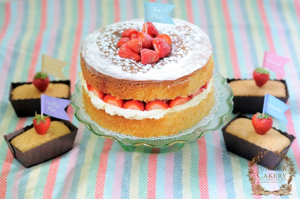 Strawberry jam and whipped cream filled Victoria Sponge Cake by Juniper Cakery