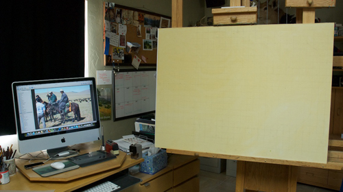 Studio set-up with reference photo, tinted panel, and pencil grid