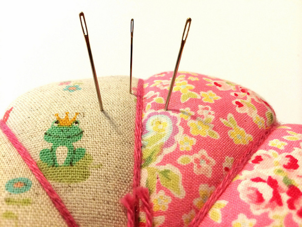 Hand Quilting Needles in a Pincushion
