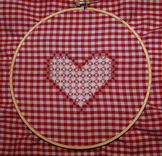 Heart shaped embroidery on red and white gingham fabric