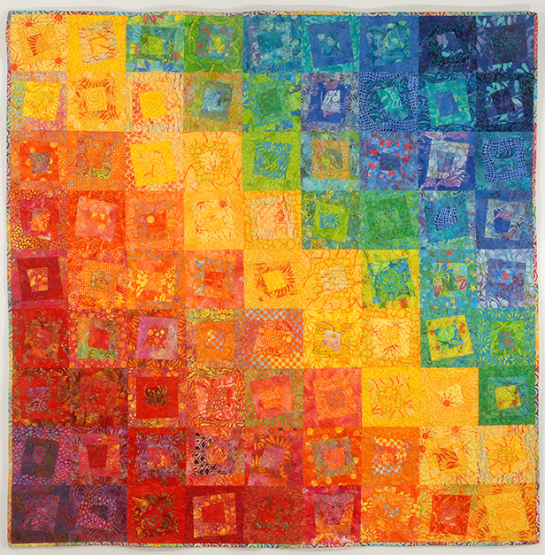 Rainbow quilt using a wide variety of fabrics