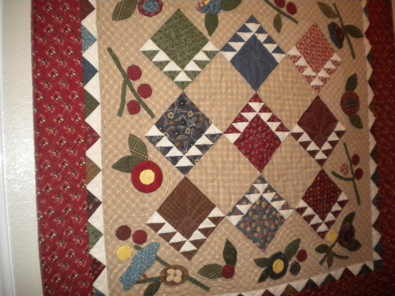 On point quilt with appliqué embellishment