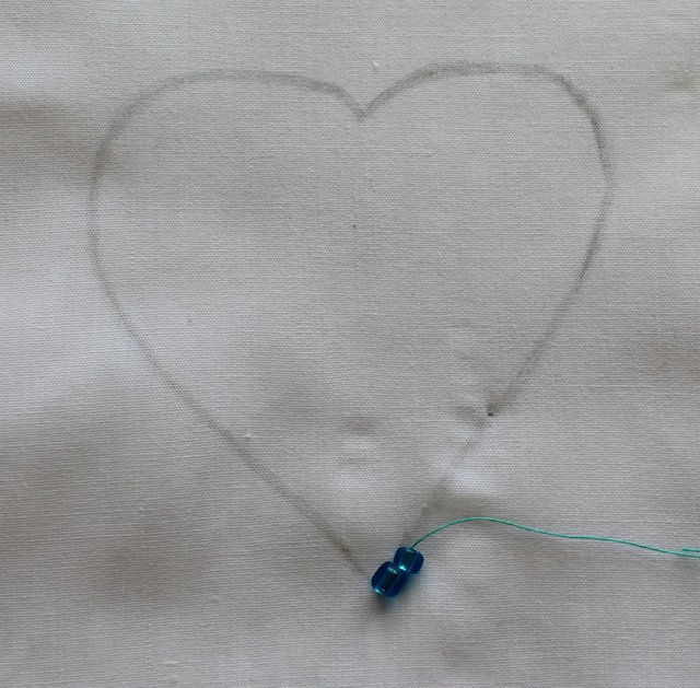 Start with two beads on your quilt.