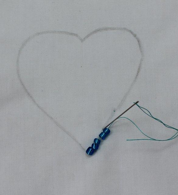 Lay 3-4 seed beads on.