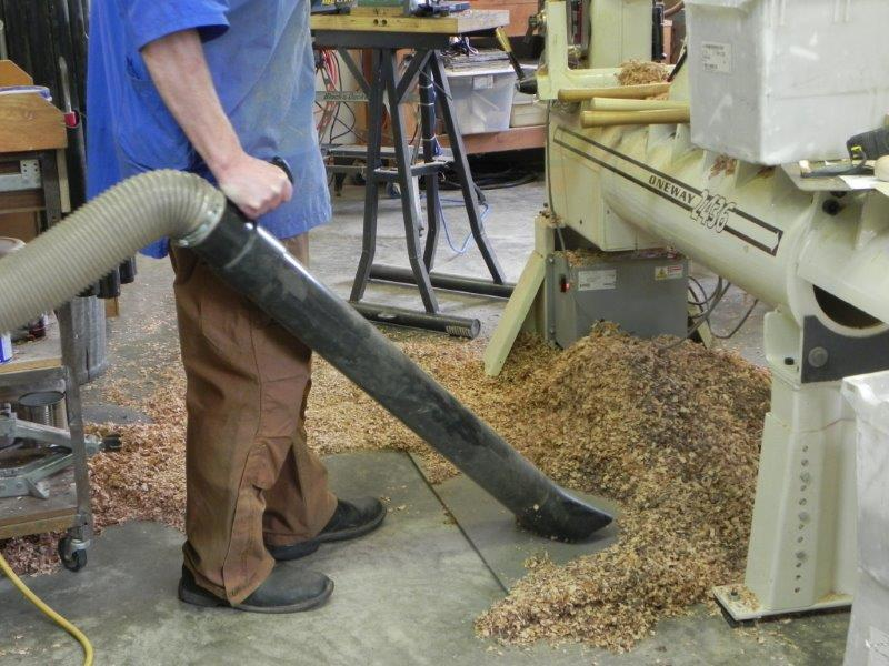 Vacuuming chips to eliminate the dust from sweeping