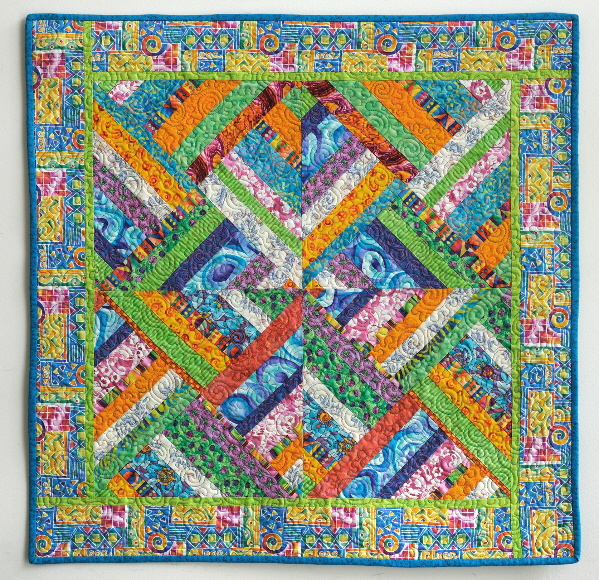 Beautiful, colorful quilt ising a focus fabric