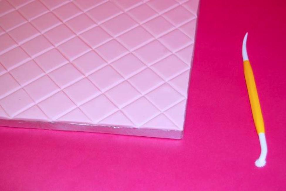 Step 4- Score the fondant across to create uniform squares