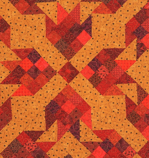 Quilt with a variety of red fabrics