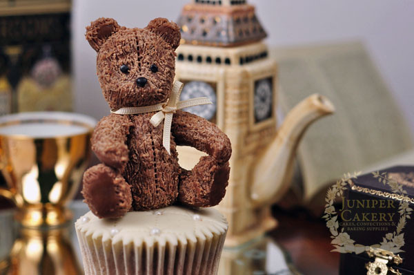 Sweet little teddy bear cupcake topper made out of modeling chocolate