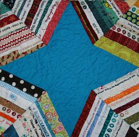 A quilt block made with selvage pieces