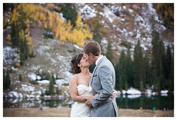 Bride and groom kissing in the mountains