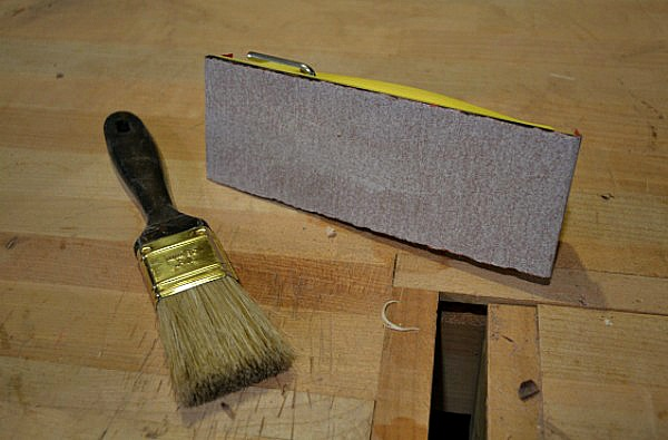 commercially-made sanding block and regular paint brush