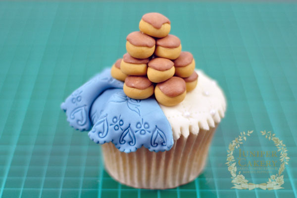 Fondant profiterole tower cupcake topper