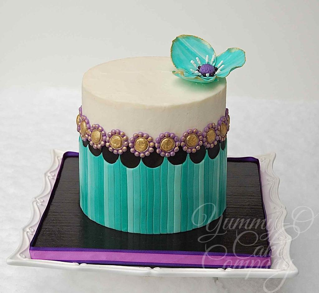 Striped Birthday Cake with Flower Topper.