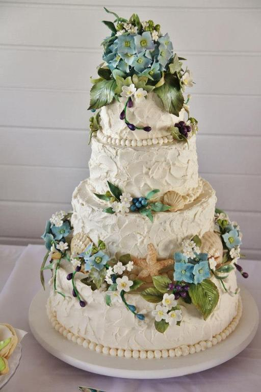 Beach wedding cake with blue flowers