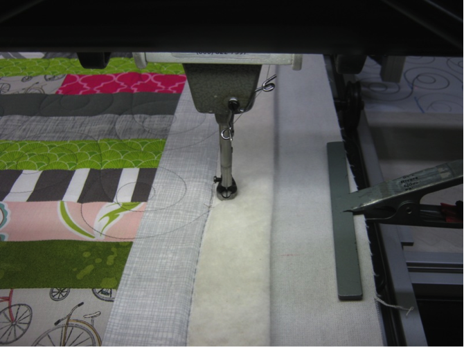 Longarm clamp keeps quilt taught to prevent tucks