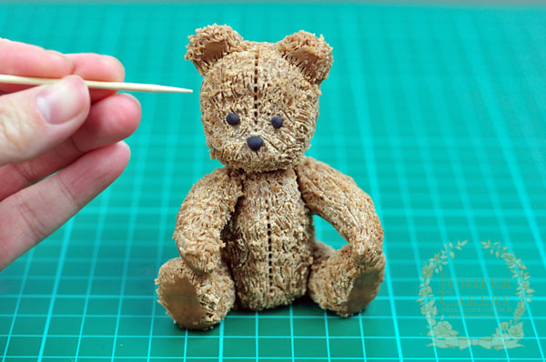 Creating fur on an antique teddy bear from modeling chocolate