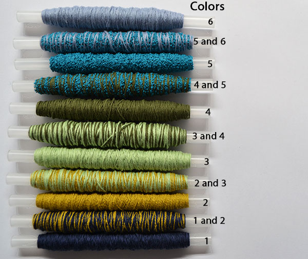 Wound bobbins in a varied colour selection for ombre weaving