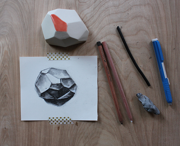 Completed charcoal drawing of a geometric shape