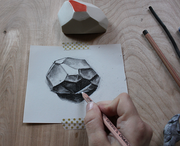 Adding white charcoal to drawing