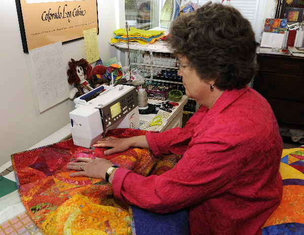 Sitting at the sewing machine with a relaxed posture