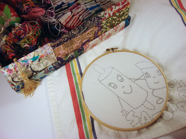 embroidering tea towels