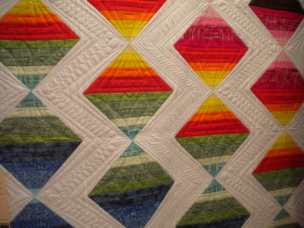 Valori Wells fabrics framed w/ white accents, quilt at Robert Kaufman booth