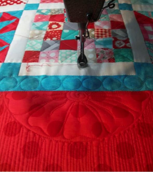 Red, white and blue patchwork quilt with crosshatching