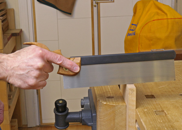 gripping the saw