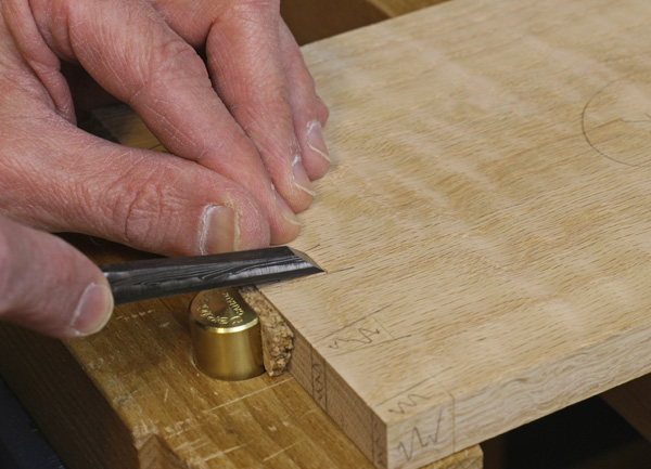 making the V cuts with a chisel