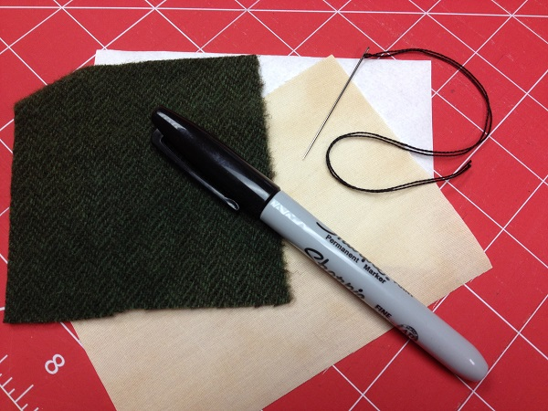Wool, fabric, needle, pearl cotton thread and marker