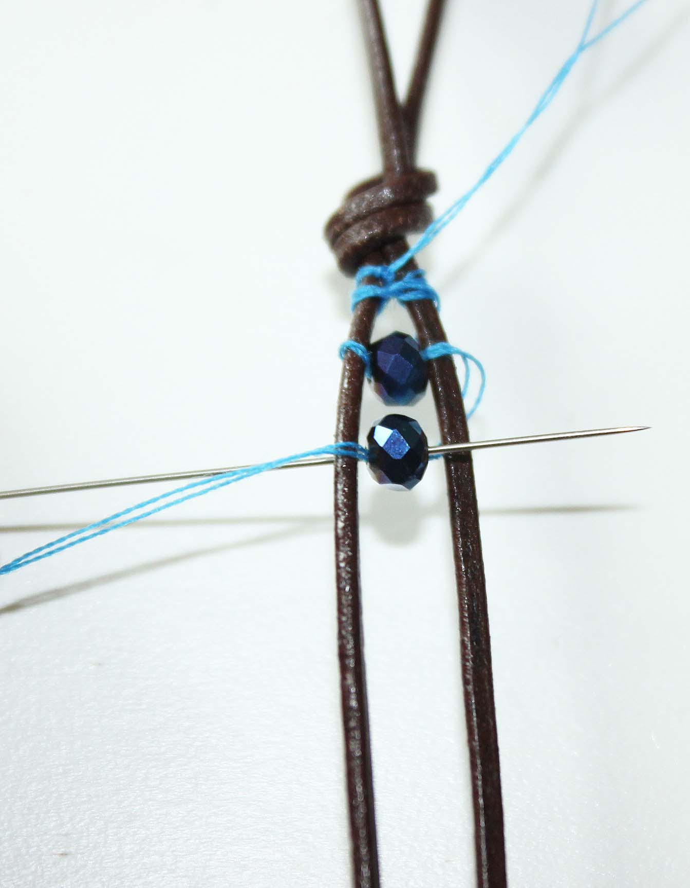Threading beads on a leather cord