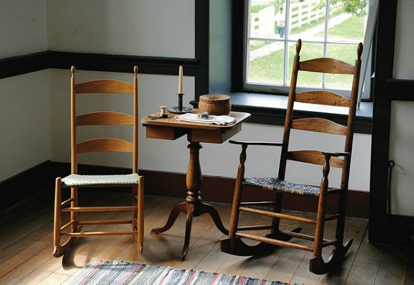Candle stand between two Shaker rocking chairs