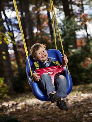 Portrait of a Little Boy on a Swing