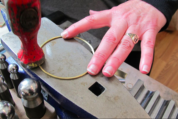 Flattening a Handmade Bangle on an Anvil