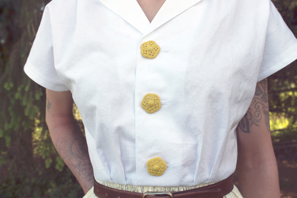 Big, Happy Yellow Vintage Buttons on a White Blouse