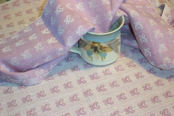 Tea towel woven with a tiny butterfly pattern