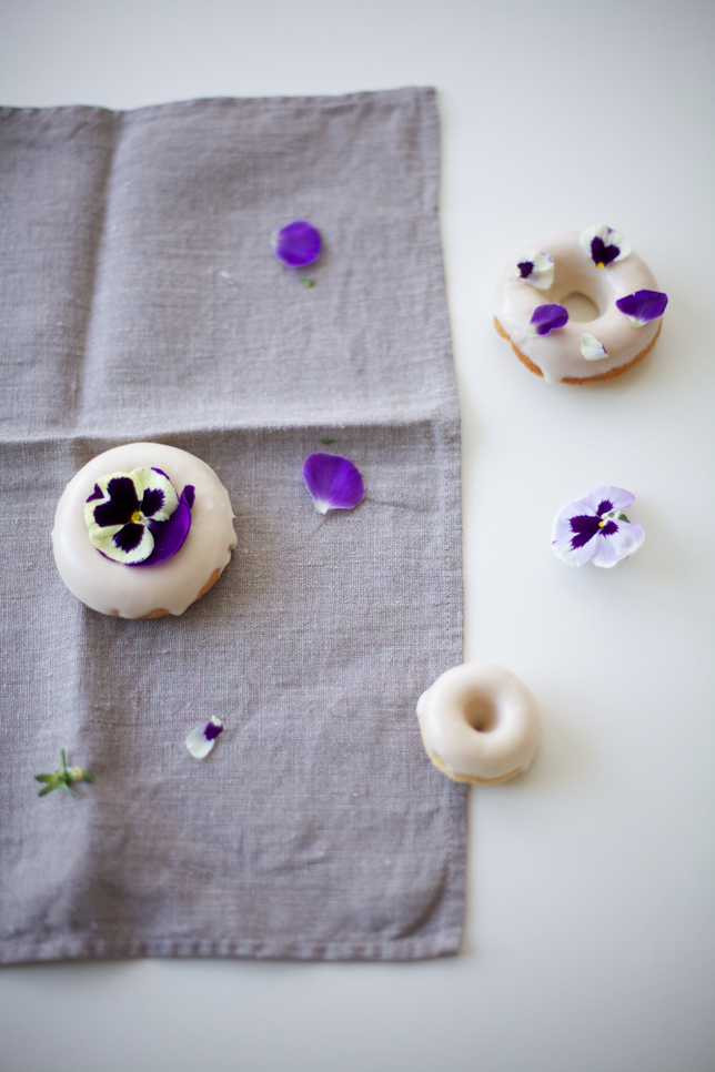 Homemade Doughnuts Decorated with Edible Pansies
