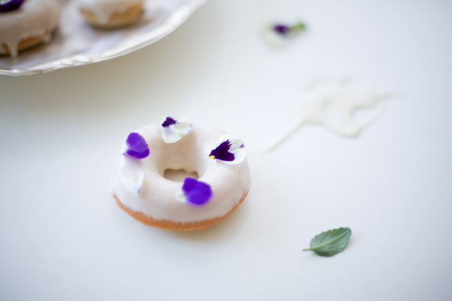 Vanilla Glazed Doughnut Topped with Purple Pansies